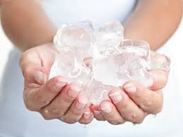 Person holding ice cubes
