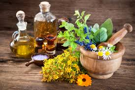 Herbs and essential oil with wooden brick and mortar
