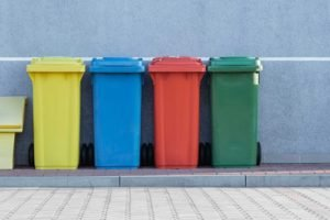 yellow, blue, red and green bins lined up