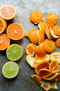 Oranges and lemons cut into half and their peels kept on one side on a grey slab- Who Who Carpet Cleaning Brisbane