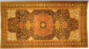 Bright orange-red rug with intricate design in green and brown - Who Who Carpet Cleaning Blog