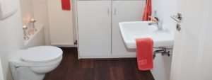 white compact bathroom with wc and sink