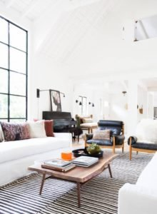 Modern living room with white couch and classic rug