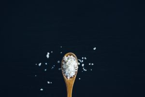 Brown spoon filled with coarse salt- Image for blog Who who Carpet cleaning