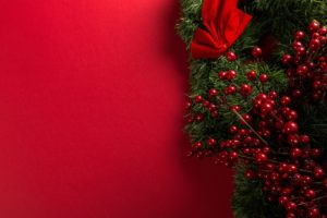 Bright Red Background with Christmas berries on one side
