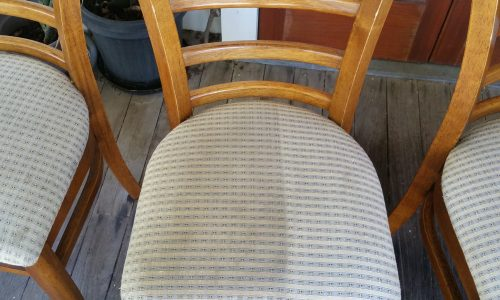 Beige wooden chair cleaned half and half to show the difference before and after Who Who Carpet Cleaning