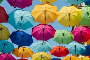 Colorful umbrellas lined up at the roof