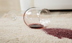 Red wine spilt on beige carpets