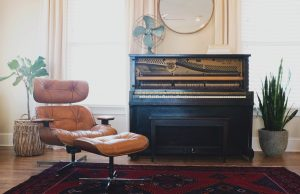 Leather recliner, Black piano in a wide living room - Image used in professional leather cleaning blog